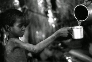 giving cup of cold water
